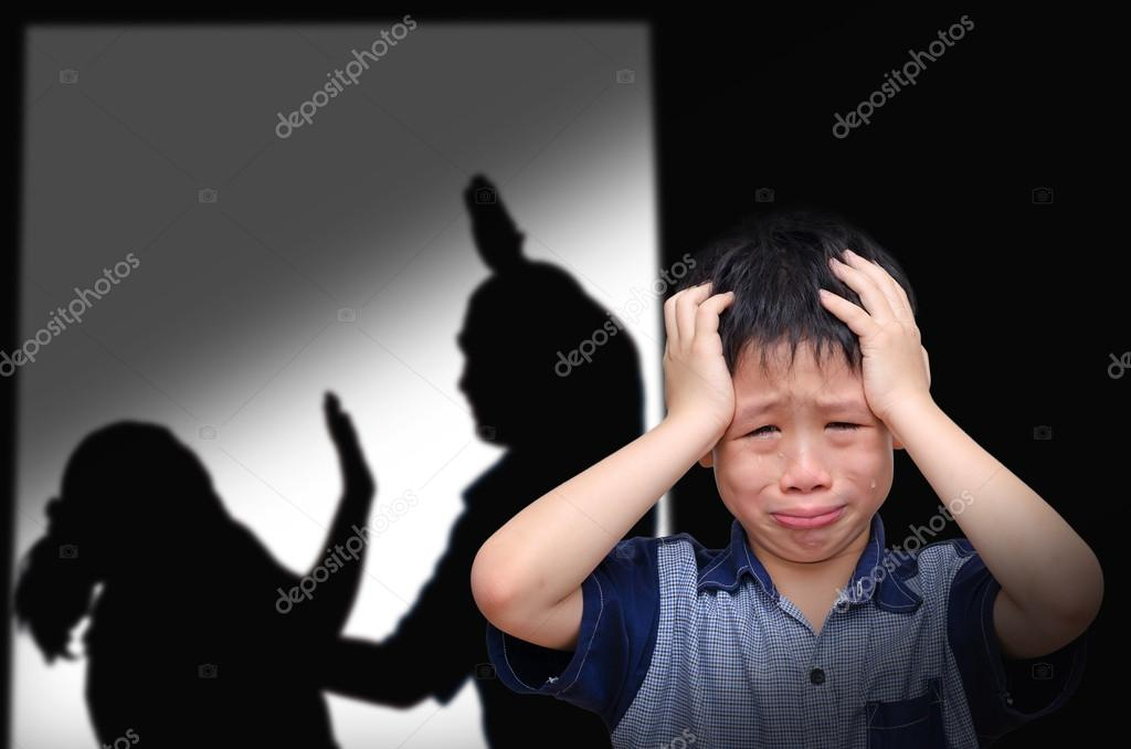 Boy crying with his parent fighting