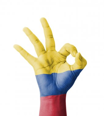 Hand making Ok sign, Colombia flag painted as symbol of best qua
