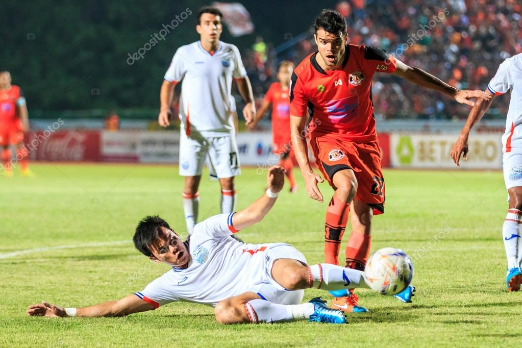 e9197dac70fb6 SISAKET THAILAND-APRIL 4  Victor Amaro of Sisaket FC. (orange) in action  during Thai Premier League between Sisaket FC and Port FC at Sri Nakhon  Lamduan ...