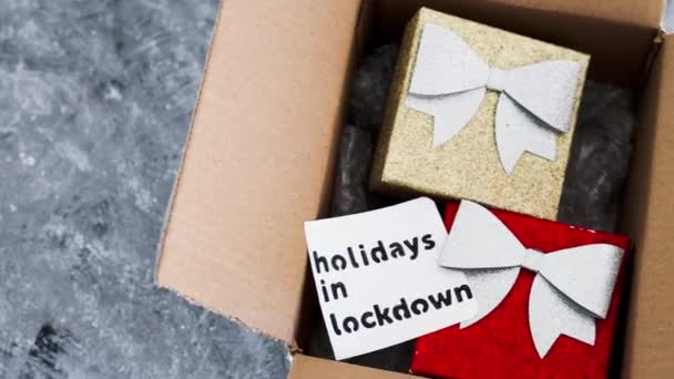 winter holidays in lockdown, gifts being delivered via postal parcel with Christmas themed items inside of it and camera panning