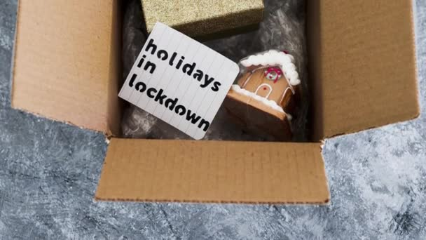 winter holidays in lockdown, gifts being delivered via postal parcel with Christmas themed items inside of it, camera tilting