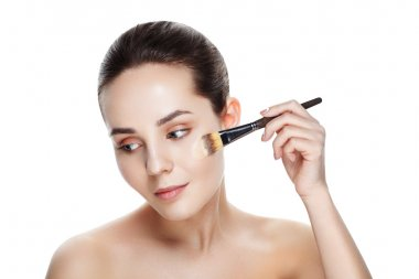 Beauty Girl with Makeup Brushes. Natural Makeup for Brunette Wom