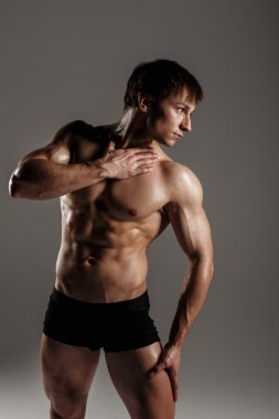 Strong Athletic Man showing muscular body and sixpack abs. Showi