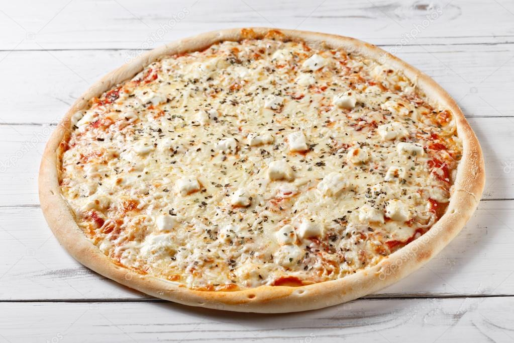 Delicious Four Cheeses Pizza Served On Wooden Table. Quattro For U2014 Stock  Photo