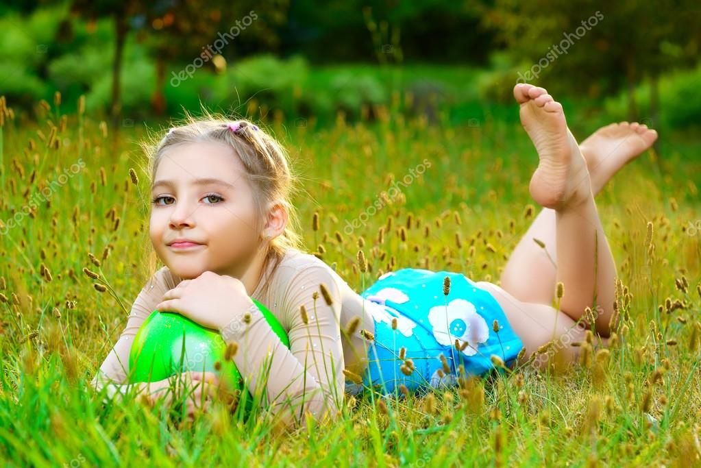 Outdoor Portrait Of Young Cute Little Girl Gymnast