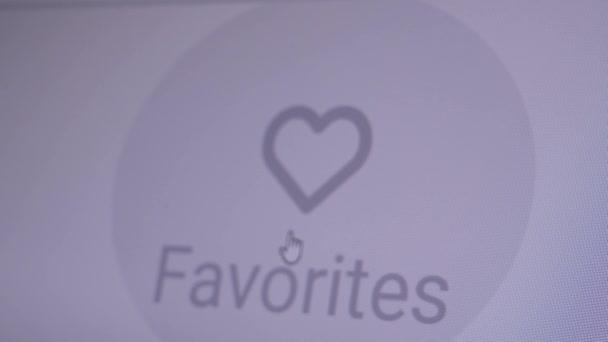Detailní záběr Kurzor myši na počítač Klikne na ikonu Srdce. Přidat k oblíbeným