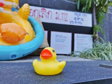 BRISBANE, AUSTRALIA - NOVEMBER 29, 2020: Yellow rubber duck represents a symbol of innocent people in the peaceful rally at King George Square, City Hall, in Brisbane Australia to protest the dictatorship of the prime minister Prayuth Chan-ocha
