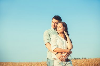 Young couple in love outdoor.Stunning sensual outdoor portrait of young stylish fashion couple posing in summer in field. Valentine day stock vector
