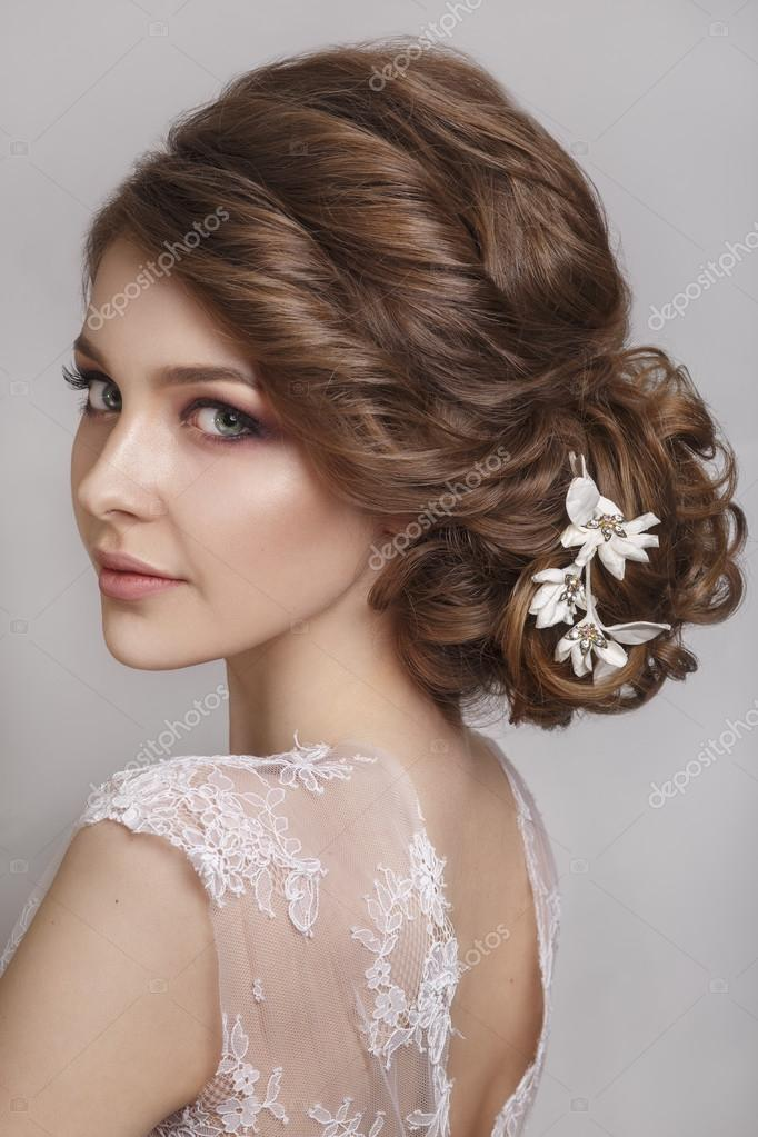 Beautiful Bride With Fashion Wedding Hairstyle On White Background