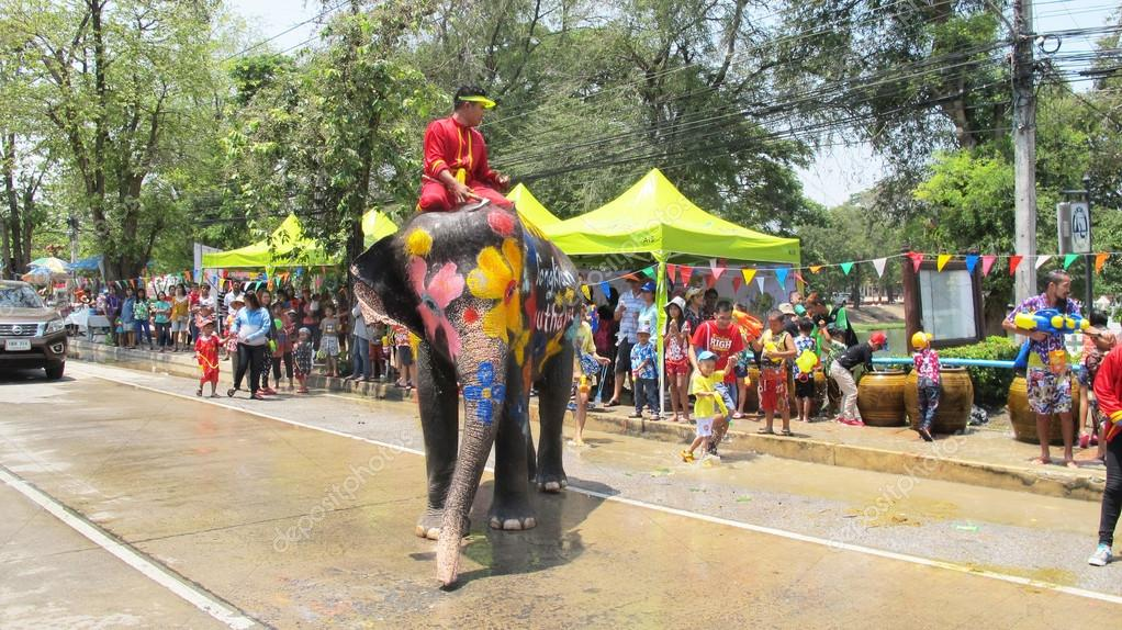 Songkran Festival is celebrated in a traditional New Year is Day from April 13 to 15, with the splashing water with elephants in Ayutthaya, Thailand.