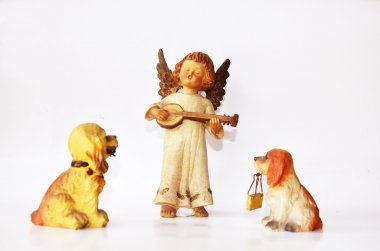 Dogs and little angel figure