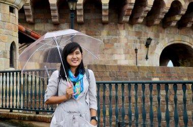 Thai woman portrait holding umbrella while raining at Wakayama M