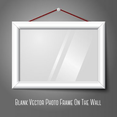 White isolated horizontal photo frame hanging on the wall, with glass.