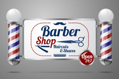 Two old fashioned vintage silver and glass barber shop poles holding Barber Sign.