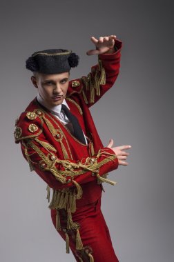 Studio shot of man dressed as Spanish matador