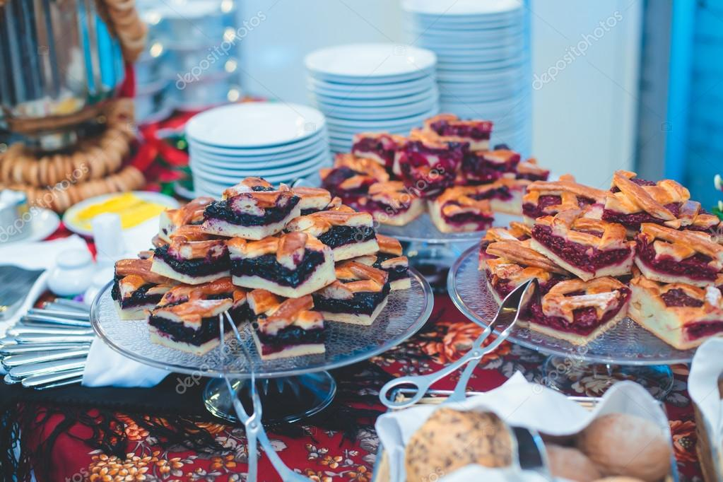 beautifully decorated catering banquet table with different food