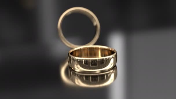 Wedding rings on glossy background