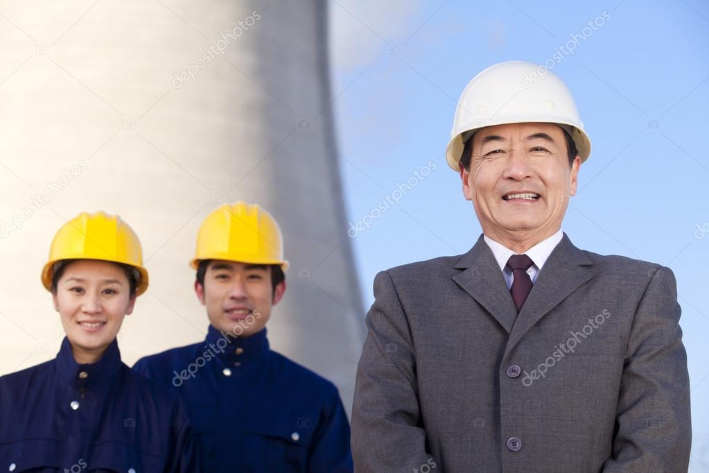 Businessman and workers in hardhats