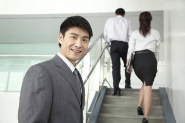 Businesspeople Going Up Stairs