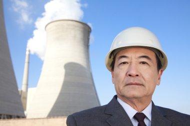 Businessman at power plant