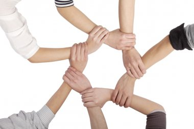 Group of Chinese friends with hands in circle