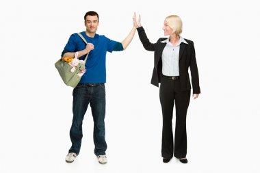 Businesswoman and husband handshakes