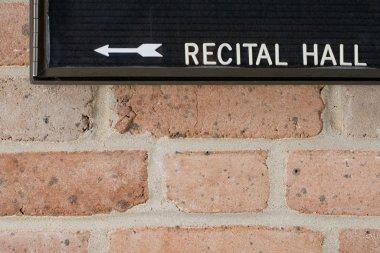 Recital hall sign on brick wall stock vector