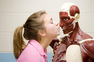 Female student kissing an anatomical model