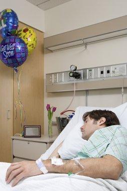 Hospital patient sleeping in bed