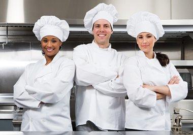 Three chefs on kitchen