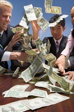 Businesspeople throwing money
