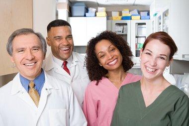 Dentists and dental nurses smiling