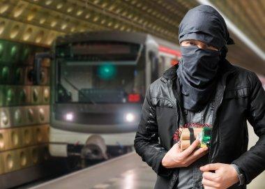 Terrorist has dynamite bomb in jacket. Train approaching underground station.