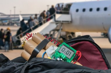 Dynamite bomb in bag in airport. Terrorism concept.