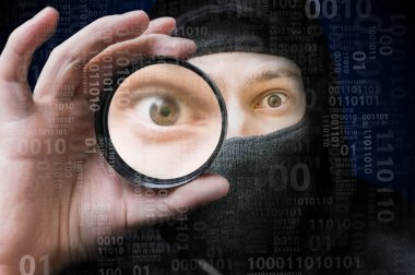 Masked anonymous hacker scanning binary code. Security concept.