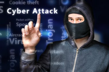 Masked anonymous hacker is pointing on Cyber attack.