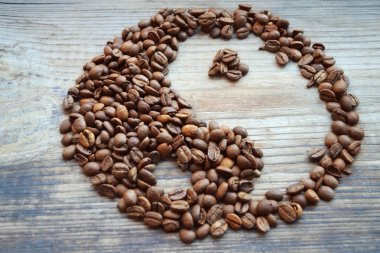 Yin yang symbol made from coffee beans