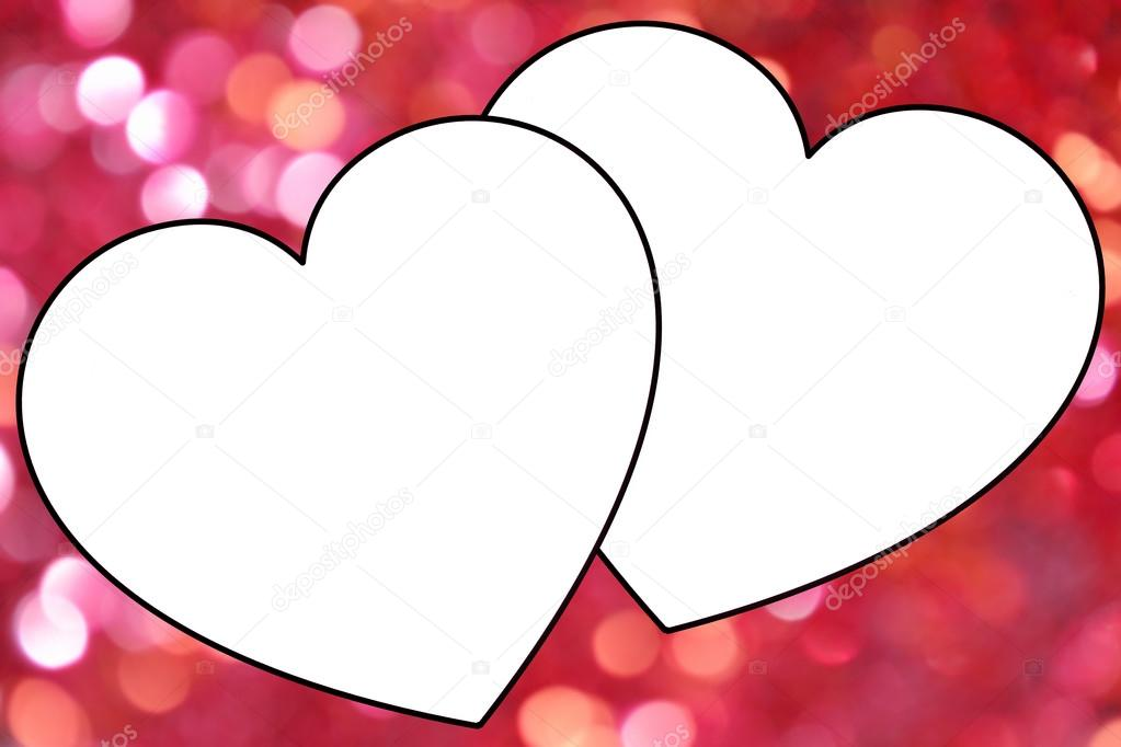 Two white hearts frame over blurred pink background with shimmering ...