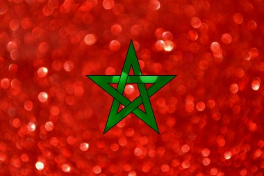 The National flag of the Kingdom of Morocco made of bright and abstract blurred backgrounds with shimmering glitter