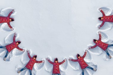 girls doing snow angels