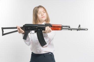 Girl holding Kalashnikov