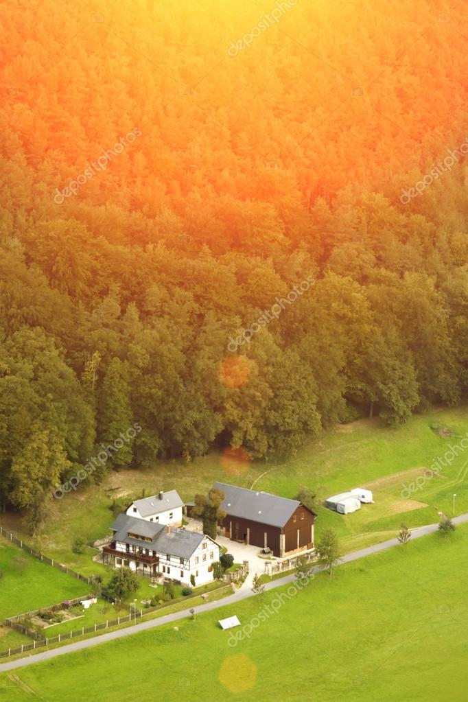 Country house forest and green fields