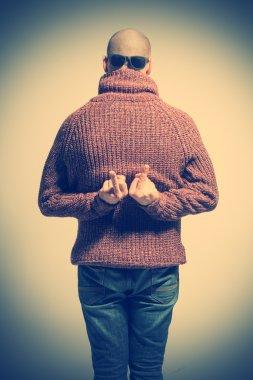 Bald man in sweater