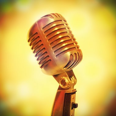 Stage microphone on a glowing background