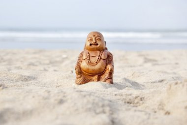 Budda statuette on the beach