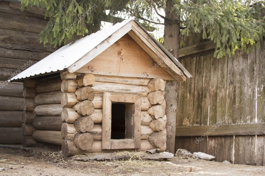 Dog house from whole logs