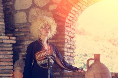 Portrait of woman wearing felt cloak