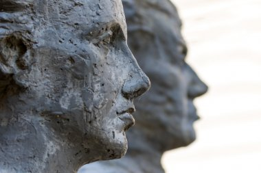 Sculptures of two people profile