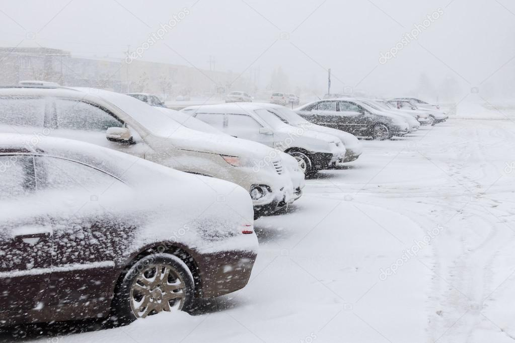 Cars on parking under snow