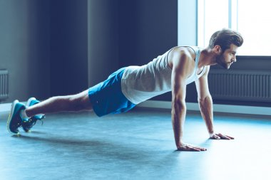 young handsome man doing push-up